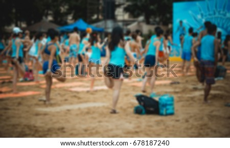 Bokeh background of people doing work out on beach #678187240
