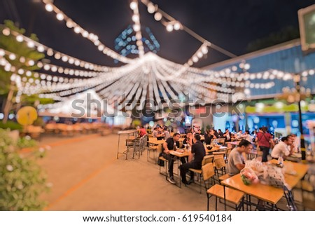 Bokeh background of Street Bar beer restaurant, outdoor in asia, People sit chill out and hang out and listen to music together, Happy life ,work hard play hard , Local street restaurant Business icon