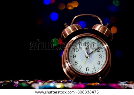 bokeh background with  alarm clock and black border at midnight