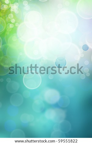 Bokeh circles of light on green tone vertical background, space for advertising copy