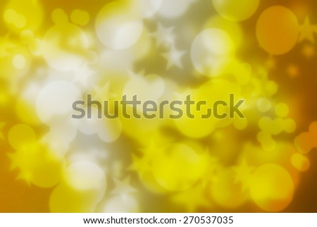 Bokeh circles,star on light yellow background.