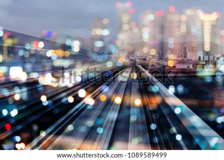 Bokeh city downtown night light with train track over, abstract background #1089589499