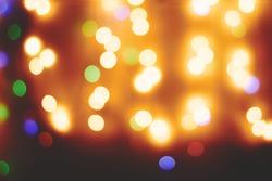 Bokeh defocused lights Christmas lights background Blurred lights Multicolored holiday lights