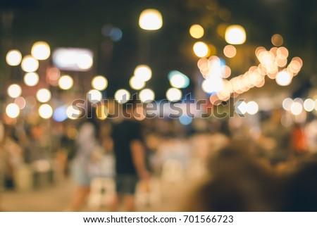 Bokeh from lighting on night walking street #701566723