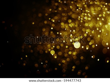 Bokeh light abstract gold color christmas light blurred on black background  #594477743