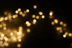 Bokeh light background.  Holiday glowing backdrop. Defocused Background With Blinking Stars. Blurred Bokeh.