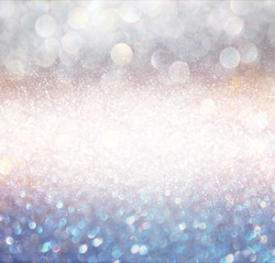 bokeh lights background with multi layers colors of white silver and blue