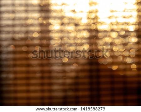 Bokeh lights of bamboo window shade #1418588279