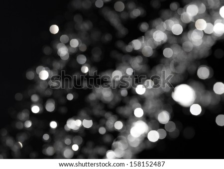 Bokeh lights on black background, shot of flying drops of water in the air, defocused water drops levitation on dark, blurred #158152487