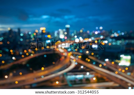 Bokeh of Bangkok skyline from above during the blue hour - Thai city scape with spectacular nightscape - defocused abstract city in the twilight.