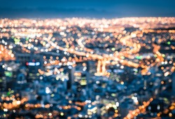 Bokeh of Cape Town skyline from Signal Hill after sunset during the blue hour - South Africa modern city with spectacular nightscape panorama - Blurred defocused night lights