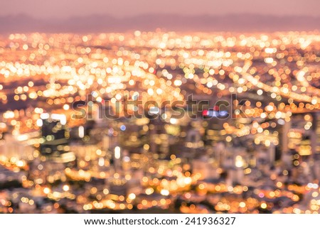 Bokeh of Cape Town skyline from Signal Hill after sunset during the blue hour - South Africa modern city with spectacular nightscape panorama - Warm blurred defocused night lights