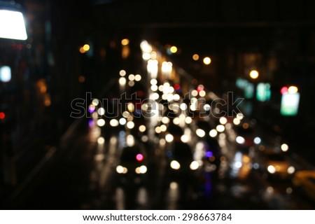 bokeh of traffic light in raining night of Bangkok
