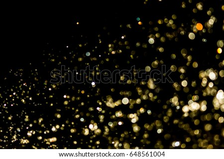 bokeh of water  and lights on black background #648561004
