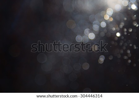bokeh of water fly and lights on black background #304446314