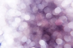 Bokeh on purple blurred background, purple glitter, out of focus