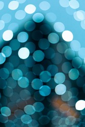 Bokeh texture of blue lights in the streets, perfect for text background.