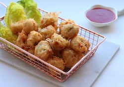 Bola bola ikan rambutan or Bakso rambutan goreng  is Fried fish balls made from fish or prawn, vermicelli, egg, carrot, mushroom and  small amout of flour and deep fried. Served with chili sauce.