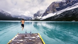 Bold jump into the cold waters of Maligne Lake in Jasper National Park