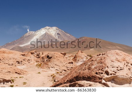 Bolivia - the most beautifull Andes in South America. The surreal landscape is nearly treeless, punctuated by gentle hills and volcanoes near Chilean border. The picture present volcano Ollague