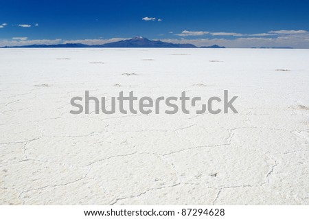 Bolivia -  the world's largest salt flat sits at a lofty 3653m and blankets an amazing 12,106  sq km, the surreal landscape. The picture present salt flat desert