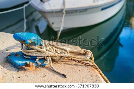 Bollard anchor at harbor. #571907830