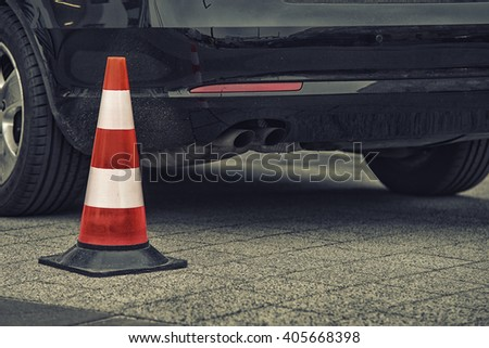 bollard next to car. no parking on pavement concept #405668398