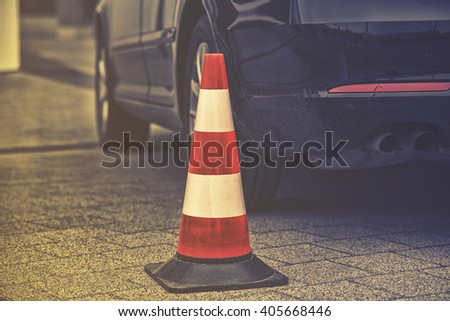 bollard next to car. no parking on pavement concept #405668446