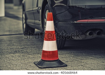 bollard next to car. no parking on pavement concept #405668464