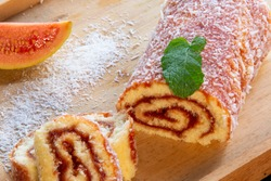 Bolo de Rolo (Swiss roll, Roll cake) typical Brazilian dessert, from the northeast region. Sliced ​​cake roll with guava paste.