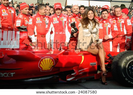 BOLOGNA,ITALY-06 DECEMBER 2008: Ferrari racing team , ferrari pilot and the beautiful argentinian Belen rodriguez, venue of the event, pose for the photographer, Bologna Italy