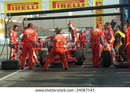 BOLOGNA,ITALY-06 DECEMBER 2008: Ferrari racing team simulate a classic pit stop at the 2008th edition of Motor Show in Bologna,Italy