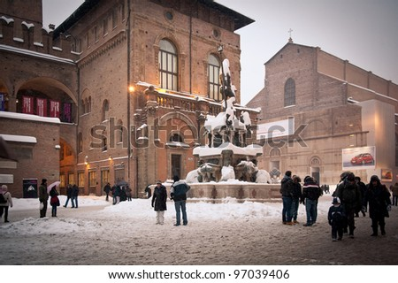 BOLOGNA, ITALY - FEBRUARY 4: People enjoying snow in Neptune square, February 4, 2012 in Bologna, Italy. This day has an exceptional amount of snow: 20 inches. (ARPA data).