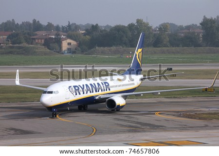 BOLOGNA - OCTOBER 16: Boeing 737 of Ryanair on October 16, 2010 at Bologna International Airport. Ryanair recently announced +8% increase in passenger numbers with 5.7M travelers for March 2011. - stock photo