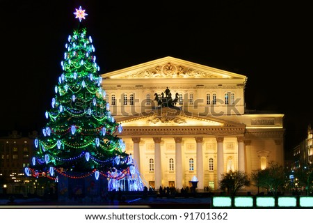 Bolshoi Theatre (Large, Great or Grand Theatre, also spelled Bolshoy) and Christmas tree at night, Moscow, Russia