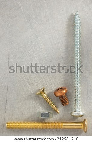 bolt, screws and nuts tool at metal background texture
