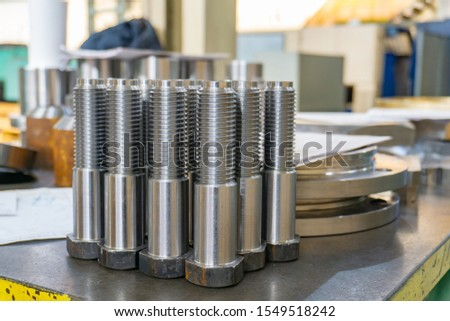 Bolts machined on a lathe from a hexagon in the machine shop.