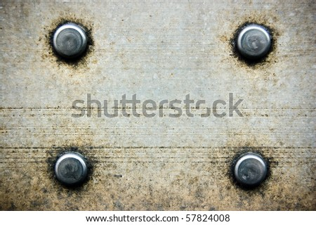 bolts on grunge textured metal background