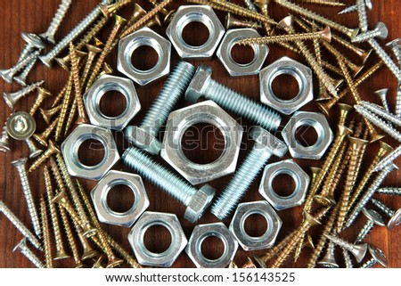 Bolts, screws and nuts on wooden table
