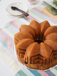 bolu keju or cheese cake with grated cheese inside with blurry background. gritty adn grainy textured