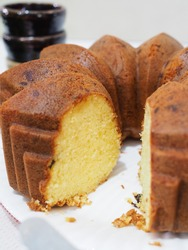 bolu keju potong or slice of cheese cake with grated cheese inside with blurry background. gritty adn grainy textured