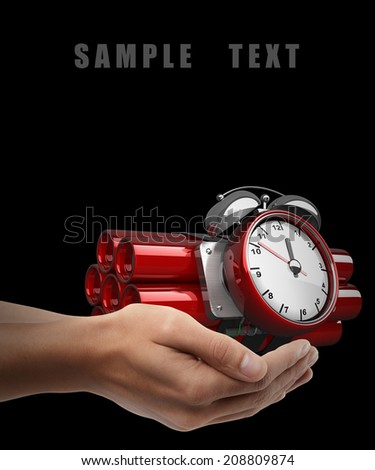 Bomb with clock timer. Man hand holding object isolated on black background. High resolution
