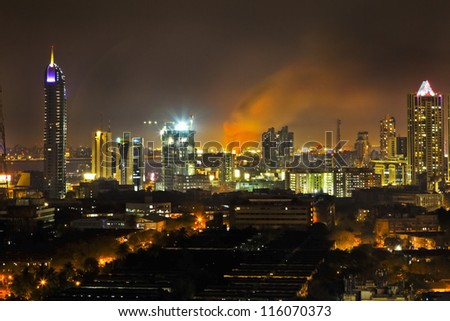 Bombay, India - March 4, 2011: Bandra Station Ablaze With Plumage Of Flames And Smoke High Into The Night Sky