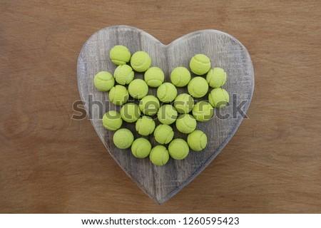 Bon bon with tennis ball design on a wooden heart