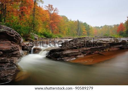 Bonanza falls Autumn waterfall near Silver City, Michigan USA - stock photo