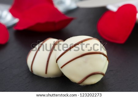 bonbons on the table with hearts
