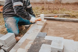 Bonding granite tiles to concrete subfloors outside the house - porch and patio cladding
