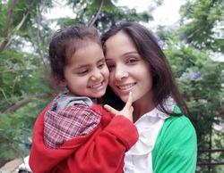 Bonding of love between mother and daughter.