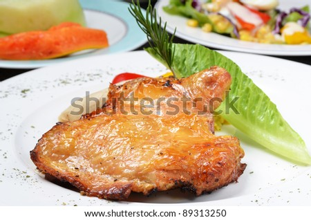 Boneless chicken leg on plate