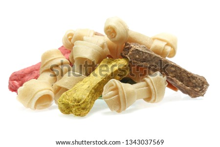bones and colorful sticks for dog treat with vitamin and oral health on white background